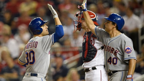 <p>               New York Mets' Michael Conforto, left, celebrates his two-run home run with Jason Vargas (40), next to Washington Nationals catcher Matt Wieters during the third inning of a baseball game Thursday, Sept. 20, 2018, in Washington. (AP Photo/Nick Wass)             </p>