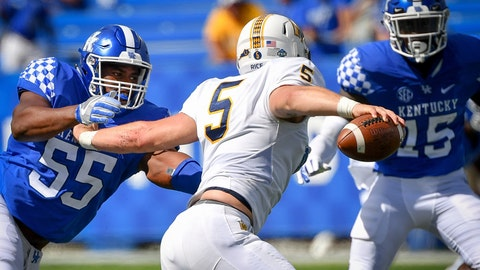 <p>               FILE - In this Saturday, Sept. 15, 2018, file photo, Kentucky defensive lineman Davoan Hawkins (55) and linebacker Jordan Wright (15) pressures Murray State quarterback Preston Rice (5) during the second half an NCAA college football game in Lexington, Ky. The Wildcats defense have held up their end by shutting out opponents in the third quarter in particular, but face their biggest challenge against No. 14 Mississippi State and mobile quarterback Nick Fitzgerald on Saturday. (AP Photo/Bryan Woolston, File)             </p>