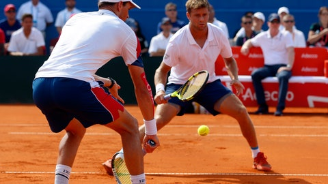 <p>               Mike Bryan, left, of the US returns a shot to Ivan Dodig and Mate Pavic during the Davis Cup semifinal double match between Croatia and the United States in Zadar, Croatia, Saturday, Sept. 15, 2018. (AP Photo/Darko Bandic)             </p>