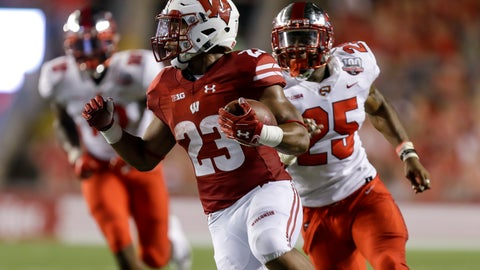 <p>               Wisconsin running back Jonathan Taylor runs for a touchdown as Western Kentucky linebacker Masai Whyte (25) give chase during the first half of an NCAA college football game Friday, Aug. 31, 2018, in Madison, Wis. (AP Photo/Andy Manis)             </p>