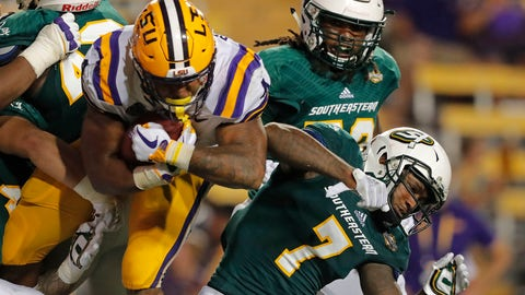 <p>               LSU running back Nick Brossette (4) carries against Southeastern Louisiana defensive back Xavier Lewis (7) in the second half of an NCAA college football game in Baton Rouge, La., Saturday, Sept. 8, 2018. LSU won 31-0. (AP Photo/Gerald Herbert)             </p>