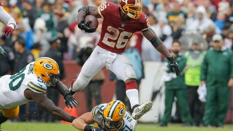 <p>               Washington Redskins running back Adrian Peterson (26) leaps over Green Bay Packers linebacker Kyler Fackrell (51) during the second half of an NFL football game, Sunday, Sept. 23, 2018 in Landover, Md. The Redskins defeated the Packers 31-17. (AP Photo/Carolyn Kaster)             </p>