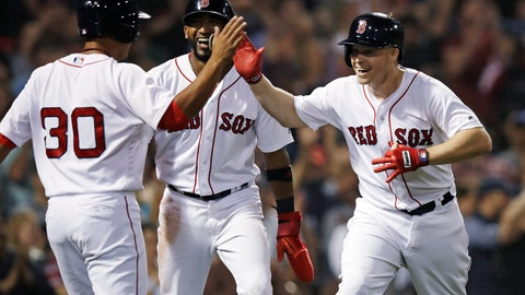 <p>               Boston Red Sox's Brock Holt, right, celebrates with Tzu-Wei Lin (30) and Eduardo Nunez, center, after his pinch-hit, three-run home run off Toronto Blue Jays relief pitcher Ryan Tepera during the seventh inning of a baseball game at Fenway Park in Boston, Tuesday, Sept. 11, 2018. (AP Photo/Charles Krupa)             </p>