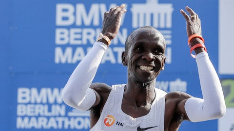 <p>               Eliud Kipchoge celebrates winning the 45th Berlin Marathon in Berlin, Germany, Sunday, Sept. 16, 2018. Eliud Kipchoge set a new world record in 2 hours 1 minute 39 seconds. (AP Photo/Markus Schreiber)             </p>