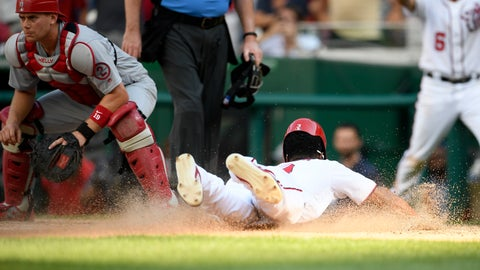 <p>               Washington Nationals' Michael Taylor slides home to score the game-winning run on a sacrifice fly by Bryce Harper during the tenth inning of a baseball game against St. Louis Cardinals catcher Carson Kelly (19), Monday, Sept. 3, 2018, in Washington. The Nationals won 4-3 in 10 innings. (AP Photo/Nick Wass)             </p>