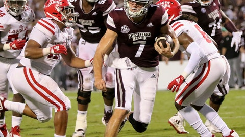 <p>               Mississippi State quarterback Nick Fitzgerald (7) sprints into the end zone for a touchdown between Louisiana-Lafayette defenders Bennie Higgins (15) and Corey Turner (6) during the first half of their NCAA college football game on Saturday, Sept. 15, 2018, in Starkville, Miss. (AP Photo/Jim Lytle)             </p>