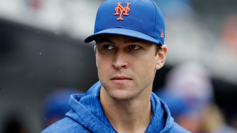 <p>               New York Mets pitcher Jacob deGrom watches from the dugout in the seventh inning of a baseball game against the Philadelphia Phillies, Sunday, Sept. 9, 2018, in New York. He was scheduled to pitch the game but was scratched beforehand. (AP Photo/Mark Lennihan)             </p>