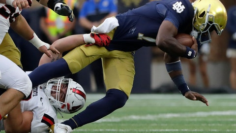 <p>               Notre Dame quarterback Brandon Wimbush, right, is sacked by Ball State defensive tackle Chris Crumb during the second half of an NCAA college football game in South Bend, Ind., Saturday, Sept. 8, 2018. Notre Dame won 24-16. (AP Photo/Nam Y. Huh)             </p>