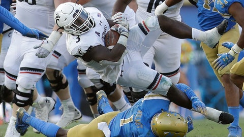 <p>               Cincinnati running back Michael Warren II, top, is tackled by UCLA defensive back Darnay Holmes (1) during the second half of an NCAA college football game Saturday, Sept. 1, 2018, in Pasadena, Calif. (AP Photo/Marcio Jose Sanchez)             </p>