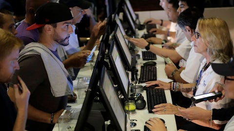 <p>               FILE - In this July 14, 2018, file photo, people, left, talk to tellers while placing bets at the Meadowlands Racetrack, in East Rutherford, N.J.   Dozens of states are rushing to capitalize on the U.S. Supreme Court lifting a federal ban on sports gambling. (AP Photo/Julio Cortez, File)             </p>