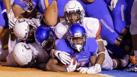 <p>               Boise State wide receiver Akilian Butler (81) looks up from under the pile of players he dragged in to the end zone for a touchdown against Connecticut in the second half of an NCAA college football game, Saturday, Sept. 8, 2018, in Boise, Idaho. Boise State won 62-7. (AP Photo/Steve Conner)             </p>