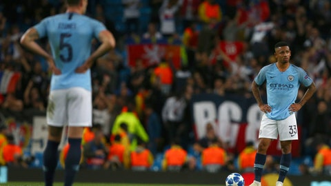 <p>               Manchester City's Gabriel Jesus, right, and Manchester City's John Stones, left, stand with their hands on their hips after Lyon score their second goal during the Champions League Group F soccer match between Manchester City and Lyon at the Etihad stadium in Manchester, England, Wednesday, Sept. 19, 2018. (AP Photo/Dave Thompson)             </p>