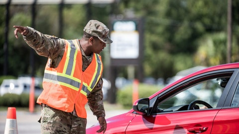 A National Guardsman directs traffic onto U.S. Highway 501 as Hurricane Florence approaches the East Coast Wednesday Sept. 12 2018 near Conway S.C. Time is running short to get out of the way of Hurricane Florence a monster of a storm