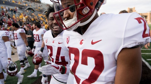 <p>               Washington State safety Jalen Thompson (34) and safety Deion Singleton (22) react after the team's 41-19 win over Wyoming during an NCAA college football game Saturday, Sept. 1, 2018, in Laramie, Wyo. (Tyler Tjomsland/The Spokesman-Review via AP)             </p>