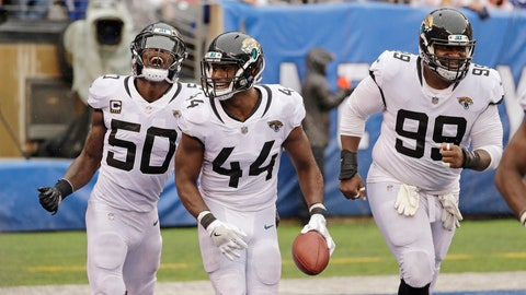 <p>               Jacksonville Jaguars' Myles Jack (44) celebrates with teammtes Telvin Smith (50) and Marcell Dareus (99) after returning an interception for a touchdown during the second half of an NFL football game against the New York Giants Sunday, Sept. 9, 2018, in East Rutherford, N.J. The Jaguars won 20-15. (AP Photo/Seth Wenig)             </p>