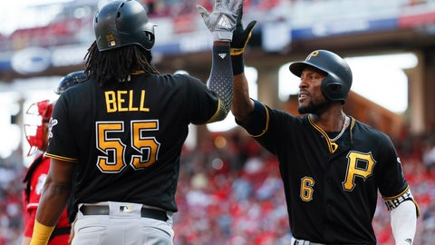 <p>               Pittsburgh Pirates' Starling Marte (6) celebrates with Josh Bell (55) after hitting a solo home run off Cincinnati Reds starting pitcher Matt Wisler in the sixth inning of a baseball game, Sunday, Sept. 30, 2018, in Cincinnati. (AP Photo/John Minchillo)             </p>