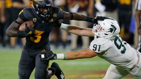 <p>               Arizona State running back Eno Benjamin (3) gives Michigan State defensive end Jack Camper (91) a stiff arm as he tries to get past during the second half of an NCAA college football game Saturday, Sept. 8, 2018, in Tempe, Ariz. Arizona State defeated Michigan State 16-13. (AP Photo/Ross D. Franklin)             </p>