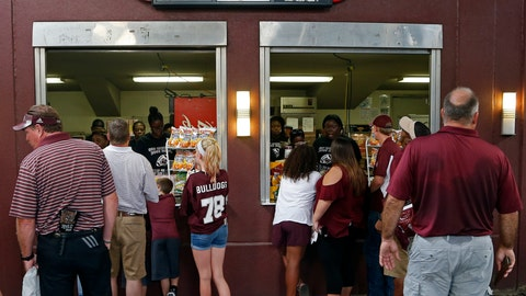 <p>               In this Sept. 1, 2018, photo, fans work their way to the snack bar where discounted prices await them at Davis Wade Stadium at Mississippi Stare, prior to their NCAA college football game against Stephen F. Austin in Starkville, Miss. The SEC saw a drop of more than 2,400 fans per game last season, which was the biggest decline of any Power Five conference. And in an effort to attract and keep more fans, Mississippi State dropped prices of some concessions, as one of the fan enticements. (AP Photo/Rogelio V. Solis)             </p>