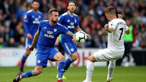 <p>               Cardiff City's Joe Ralls, left, and Burnley's Johann Gudmundsson battle for the ball during their English Premier League soccer match at the Cardiff City Stadium, Cardiff, Wales, Sunday, Sept. 30, 2018. (Nick Potts/PA via AP)             </p>
