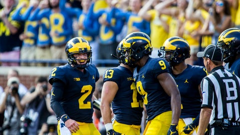 <p>               Michigan quarterback Shea Patterson (2) and wide receiver Donovan Peoples-Jones (9) celebrate with teammates their touchdown in the second quarter of an NCAA college football game against SMU in Ann Arbor, Mich., Saturday, Sept. 15, 2018. (AP Photo/Tony Ding)             </p>