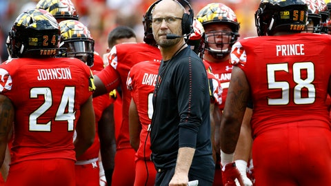 <p>               Maryland interim head coach Matt Canada, center, huddles with the team during the first half of an NCAA college football game against Texas, Saturday, Sept. 1, 2018, in Landover, Md. (AP Photo/Patrick Semansky)             </p>