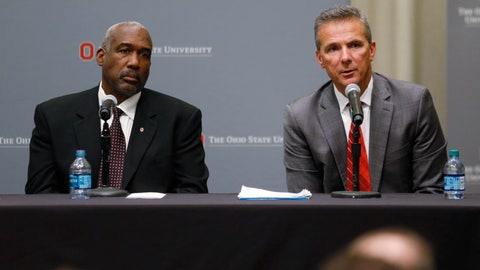 "<p>               FILE - In this Aug. 22, 2018, file photo, Ohio State football coach Urban Meyer, right, answers questions as athletic director Gene Smith listens during a news conference in Columbus, Ohio. What got Meyer in hot water? The suspended coach puts it this way: ""My fault was in not taking action sooner against a troubled employee about his work-related issues."" That now-fired assistant coach had been accused of past spousal violence as well as embarrassing sexual conduct, drug abuse and financial irresponsibility. Outside investigators found some of that affected his work life. Meyer's comments about handling that and the ensuing debate about his punishment point to a bigger question in college athletics: To what extent are coaches responsible for policing their staff's off-field behavior? (AP Photo/Paul Vernon, File)             </p>"
