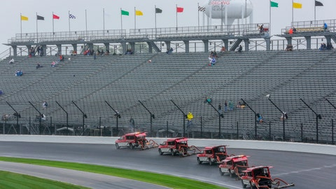 <p>               Trucks try to dry the track during a rain delay before a NASCAR Brickyard 400 auto race at Indianapolis Motor Speedway in Indianapolis, Sunday, Sept. 9, 2018. The race was postponed until Monday, Sept. 10. (AP Photo/R Brent Smith)             </p>