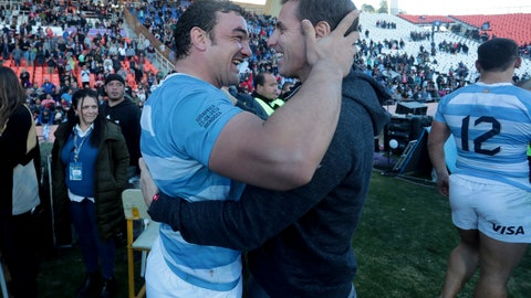 <p>               Argentina's Agustin Creevy, left, embraces team assistant Gonzalo Quesada after a rugby Championship match against South Africa, in Mendoza, Argentina, Saturday, Aug. 25, 2018. (AP Photo/Gonzalo Prados)             </p>