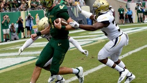 <p>               South Florida quarterback Blake Barnett (11) gets in for a touchdown during the fourth quarter of an NCAA football game against the Georgia Tech, Saturday, Sept. 8, 2018, in Tampa, Fla. (AP Photo/Jason Behnken)             </p>