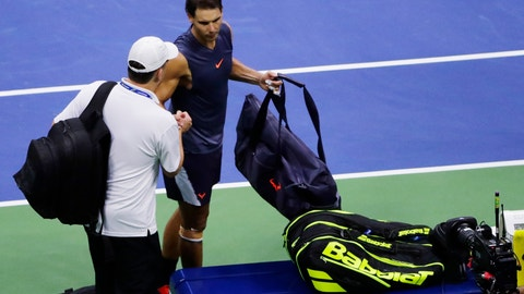 <p>               Rafael Nadal, of Spain, shakes hands with a trainer after Nadal retired from a math against Juan Martin del Potro, of Argentina, during the semifinals of the U.S. Open tennis tournament, Friday, Sept. 7, 2018, in New York. (AP Photo/Frank Franklin II)             </p>