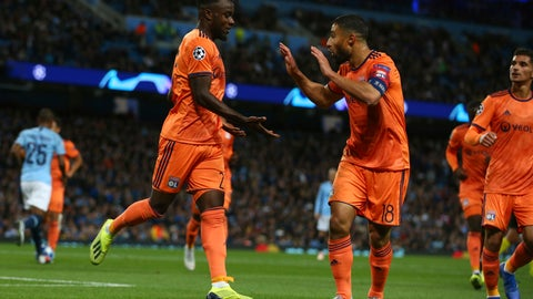 <p>               Lyon's Maxwel Cornet, left, celebrates with Lyon's Nabil Fekir after scoring his sides first goal during the Champions League Group F soccer match between Manchester City and Lyon at the Etihad stadium in Manchester, England, Wednesday, Sept. 19, 2018. (AP Photo/Dave Thompson)             </p>