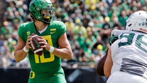 <p>               FILE - In this Sept. 8, 2018, file photo, Oregon quarterback Justin Herbert (10) looks for a receiver against Portland State during an NCAA college football game in Eugene, Ore. A couple of Pac-12 stars have a chance to put themselves into the Heisman mix on Saturday night when No. 7 Stanford visits No. 20 Oregon. Herbert has put up nice numbers in the first three weeks of the season, with 10 touchdown passes, no interceptions and 10.4 yards per attempt. He is not quite at the Tua level, but he's not that far off. (AP Photo/Thomas Boyd, File)             </p>