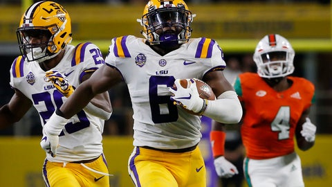 <p>               LSU linebacker Jacob Phillips (6) returns an interception for a touchdown as Miami wide receiver Jeff Thomas (4) and LSU cornerback Greedy Williams (29) look on during the first half of an NCAA college football game Sunday, Sept. 2, 2018, in Arlington, Texas. (AP Photo/Ron Jenkins)             </p>