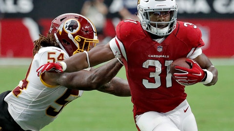 <p>               FILE - In this Sept. 9, 2018, file photo, Arizona Cardinals running back David Johnson (31) is hit by Washington Redskins linebacker Mason Foster (54) during the second half of an NFL football game,  in Glendale, Ariz. The 0-2 Cardinals face the Chicago Bears on Sunday.(AP Photo/Rick Scuteri, File)             </p>