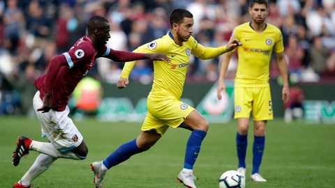 <p>               West Ham's Arthur Masuaku, left, chases Chelsea's Eden Hazard during the English Premier League soccer match between West Ham United and Chelsea at London Stadium in London, Sunday, Sept. 23, 2018. (AP Photo/Matt Dunham)             </p>