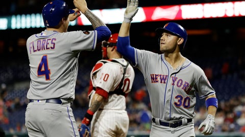 <p>               New York Mets' Michael Conforto, right, and Wilmer Flores, left, celebrate after Conforto's three-run home run off Philadelphia Phillies relief pitcher Austin Davis during ninth inning of a baseball game, Monday, Sept. 17, 2018, in Philadelphia. (AP Photo/Matt Slocum)             </p>