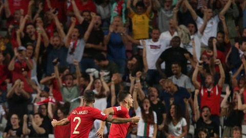 <p>               Portugal's Andre Silva, right celebrates after scoring the opening goal during the UEFA Nations League soccer match between Portugal and Italy at the Luz stadium in Lisbon, Monday, Sept. 10, 2018. (AP Photo/Armando Franca)             </p>