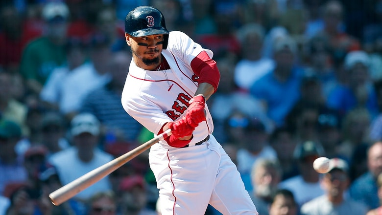 Betts hurts side, says injury minor, Red Sox near East title
