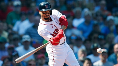 <p>               Boston Red Sox's Mookie Betts hits a sacrifice fly that scored Rafael Devers during the third inning of a baseball game against the New York Mets in Boston, Sunday, Sept. 16, 2018. (AP Photo/Michael Dwyer)             </p>