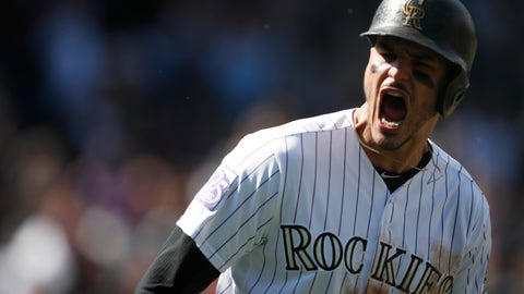 <p>               Colorado Rockies' Nolan Arenado yells as he circles the bases after hitting a two-run home run off Washington Nationals starting pitcher Erick Fedde in the first inning of a baseball game Sunday, Sept. 30, 2018, in Denver. The Rockies won 12-0. (AP Photo/David Zalubowski)             </p>