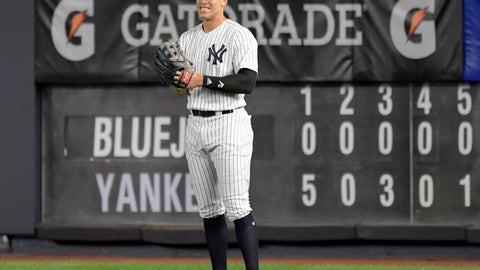 <p>               New York Yankees right fielder Aaron Judge smiles after coming into the baseball game in the eighth inning against the Toronto Blue Jays Friday, Sept.14, 2018, at Yankee Stadium in New York. (AP Photo/Bill Kostroun)             </p>