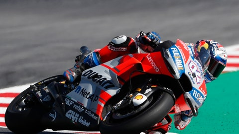 <p>               Italy's Andrea Dovizioso steers his Ducati during the San Marino Motorcycle Grand Prix at the Misano circuit in Misano Adriatico, Italy, Sunday, Sept. 9, 2018. (AP Photo/Antonio Calanni)             </p>