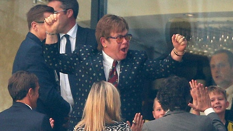 <p>               Former Watford owner Elton John celebrates in the stands after the English Premier League soccer match between Watford and Tottenham Hotspur at Vicarage Road, Watford, England, Sunday, Sept. 2, 2018. (Nigel French/PA via AP)             </p>