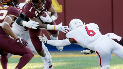 <p>               Minnesota running back Rodney Smith (1) is tackled by Fresno State's Tank Kelly (6) and Julian Huff (20) in the first quarter of an NCAA college football game, Saturday, Sept. 8, 2018, in Minneapolis. (AP Photo/Andy Clayton-King)             </p>