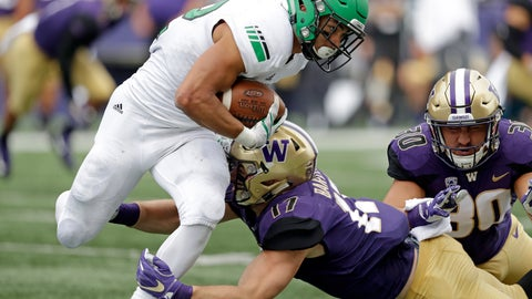 <p>               North Dakota's John Santiago, left, rushes as Washington's Tevis Bartlett (17) and Kyler Manu move in in the first half of an NCAA college football game Saturday, Sept. 8, 2018, in Seattle. (AP Photo/Elaine Thompson)             </p>