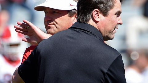 <p>               FILE - In this Oct. 9, 2016, file photo, Georgia head coach Kirby Smart, left, and South Carolina head coach Will Muschamp meet on the field before an NCAA college football game in Columbia, S.C. South Carolina has made constant improvement since bottoming out at the end of the Steve Spurrier era. But lose to Georgia on a high stakes SEC opener for both teams and the Gamecocks will likely spend another season in the national shadows. (AP Photo/Rainier Ehrhardt, File)             </p>