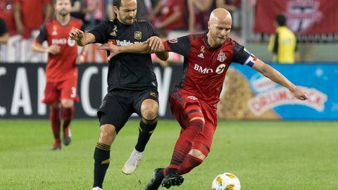 <p>               Toronto FC's Michael Bradley, right, battles for the ball with Los Angeles FC's Marco Urena during the first half of an MLS soccer game, Saturday, Sept. 1, 2018 in Toronto. (Chris Young/The Canadian Press via AP)             </p>