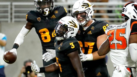 <p>               Arizona State running back Eno Benjamin (3) celebrates his touchdown with tight end Tommy Hudson, right, and wide receiver Tyerell Baldonado-Kaeiopu (84) during the second half of an NCAA college football game against Oregon State, Saturday, Sept. 29, 2018, in Tempe, Ariz. (AP Photo/Matt York)             </p>