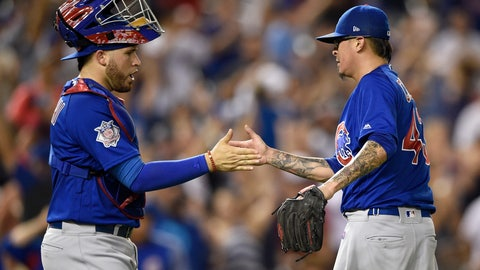 <p>               Chicago Cubs relief pitcher Jesse Chavez, right, celebrates with catcher Victor Caratini (7) after a baseball game against the Washington Nationals, Thursday, Sept. 6, 2018, in Washington. The Cubs won 6-4 in 10 innings. (AP Photo/Nick Wass)             </p>