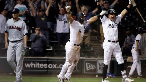 <p>               Chicago White Sox's Yolmer Sanchez, center, and Avisail Garcia, right, celebrate after Daniel Palka hit the game-winning two-run single, as Cleveland Indians relief pitcher Carlos Carrasco, left, heads to the dugout at the end of a baseball game Tuesday, Sept. 25, 2018, in Chicago. The White Sox won 5-4. (AP Photo/Nam Y. Huh)             </p>